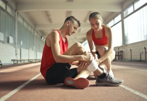 Man with Muscle Strain and Woman Helping